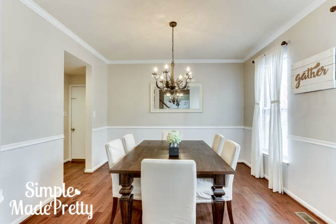 I love simple dining room decor like this minimalist dining room. The paint color is sherwin williams eder white and accessible beige. I love the clean look in this dining room decor!