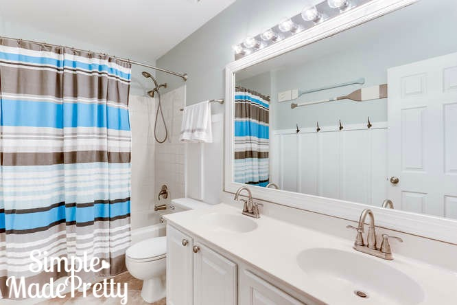 Came across this Bathroom while looking for some blue green bathroom remodel decor ideas. The apint color used is Sherwin Williams Sea Salt. This kids bathroom decor is so cute!