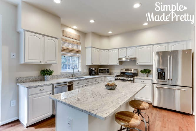 I love this white kitchen paint color! We remodeled our kitchen that was a fixer upper with brown cabinets. I painted the kitchen cabinets gray but I like this silky white color! The before and after pictures are amazing!
