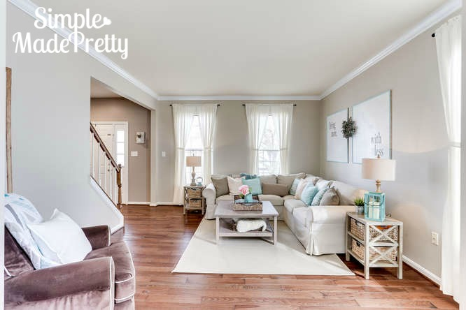 This living room decor is so simple. The living room paint color ideas are perfect! Sherwin Williams Accessible Beige is a nice neutral paint color to use in the living room.