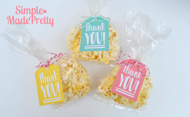 The popcorn favors are so cute and easy to make using the free printable favor tags