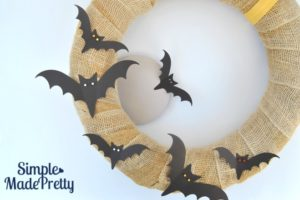 This Halloween wreath was really easy and cheap to make! I picked up the supplies at the Dollar store and hand cut the leaves in colors to match our home decor. It turned out so cute!