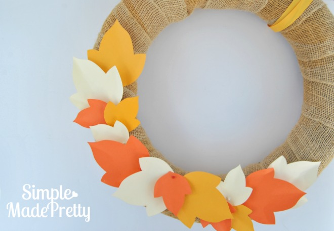 This Fall wreath was really easy and cheap to make! I picked up the supplies at the Dollar store and hand cut the leaves in colors to match our home decor. It turned out so cute!