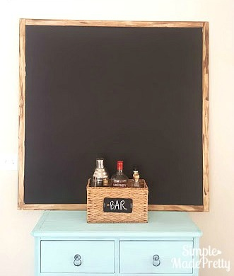 Learn how to make this over-sized chalkboard for kids or a farmhouse style home decor!