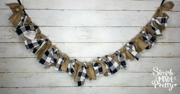 This buffalo plaid and burlap garland was so easy to make and is a fun DIY Christmas decoration in your home! Learn how to make a Burlap Christmas garland in the how-to video! #Burlapdecor #ModernBurlap #BurlapBanner